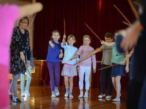 Teacher and students in Drama class