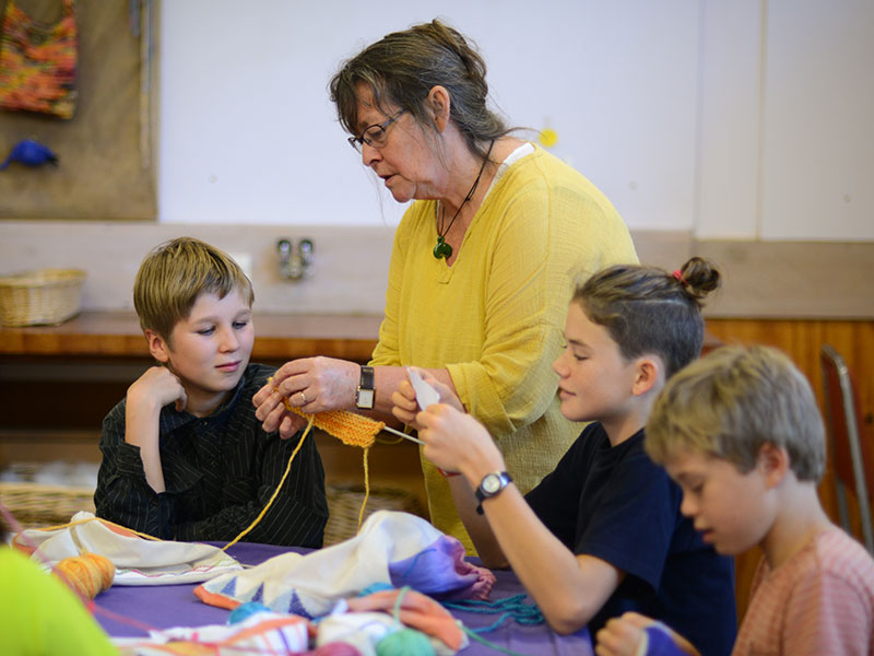 Teacher and students in Knitting class