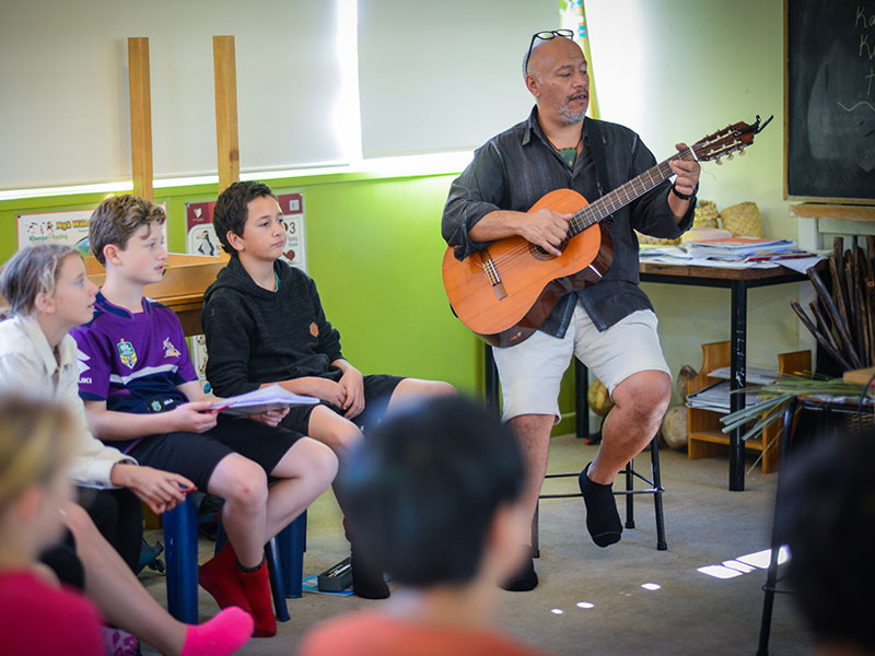 Teacher and students singing in Maori class