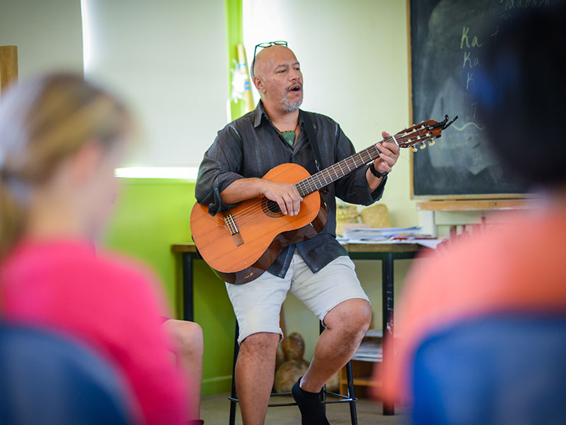 Teacher singing in Maori class