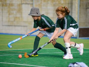 Girls playing hockey